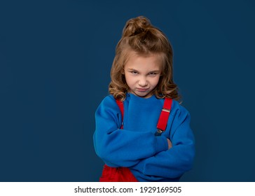 Spoiled child, naughty baby, kids whims. Beautiful little girl showing character. Child crisis psychology concept. Close-up portrait