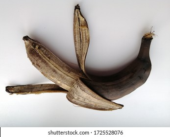 spoiled, rotten banana lies on a white background