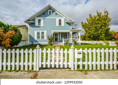 Spokane, Washington - October 1 2018: A typical quaint victorian home with a white picket fence in the Pacific Northwest area of the United States of America.