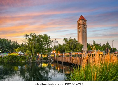 Spokane, Washington - September 1 2018: Festival goers enjoy a colorful sunset at the annual Pig out in the Park at Riverfront Park along the Spokane River in Spokane, Washington