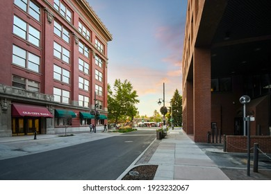 Spokane, Washington, USA - August 4 2019: The old Spokane, Washington, USA City Hall building with Riverfront Park filled with booths and vendors at sunset during a festival in the downtown.