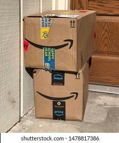 Spokane, WA/USA - August 2019: Delivered Amazon packages are sitting on a front porch after delivery