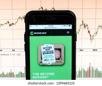 Spokane, WA/USA - May 2019: Beyond Meat website is open on a smartphone.  Stock chart is visible in the background.  Beyond Meat is a producer of plant-based meat substitutes.