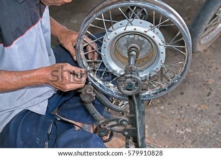 spoke adjustment motorcycles truing spoke tighten stock photo edit