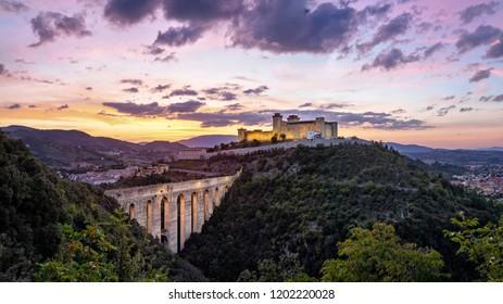 Spoleto on sunset. Ponte delle torri medieval bridge and Rocca Albornoziana hilltop fortress, Province of Perugia, Italy