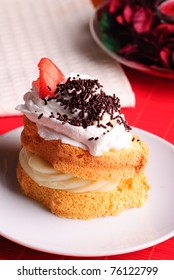 Sponge cake with custard and whipped cream