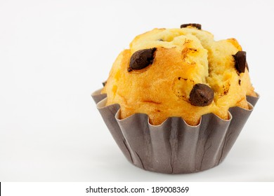 Sponge cup cake with chocolate and brown paper wrapper
