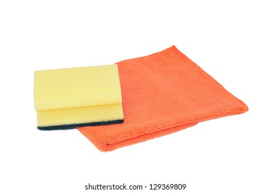 Sponge and microfiber serviette isolated on white