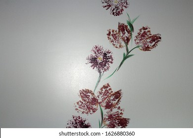 sponge painting of purple flowers on a white wall