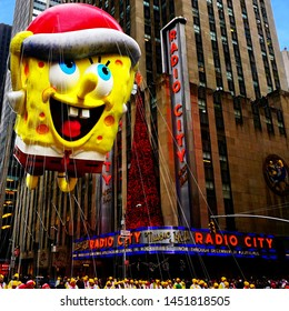 Spongebob Squarepants balloon floats in the air during Macy's Thanksgiving Day parade along the Radio City Music Hall. Manhattan, New York, USA - November 27, 2014.