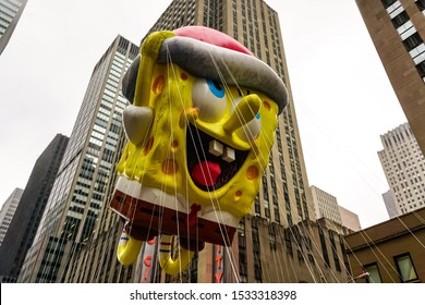 Spongebob Squarepants balloon floats in the air during Macy's Thanksgiving Day parade along Avenue of Americas with the Radio Music Hall in the background. Manhattan, New York, USA November 27, 2014