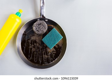 Sponges and steel wool for  clean a frying pan with dishwashing liquid