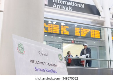 Sponsors, family, and Canadians simply wishing to welcome their new neighbours await the first plane's arrival of Syrian refugees at Toronto's Pearson International Airport on December 10, 2015.