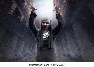 Spooky asian devil nun with blood on her mouth in abandoned place