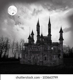 Spooky castle at midnight
