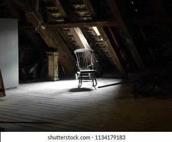 Spooky chair in attic.