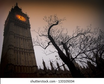 The spooky clock tower of Westminster with bare tree in autumn