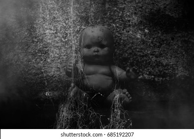 Spooky doll in haunted house