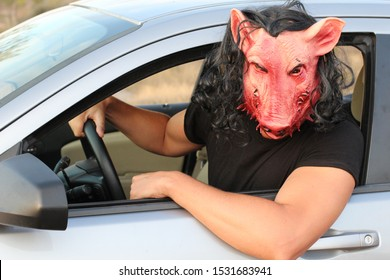 Spooky driver wearing a mask