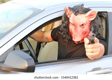 Spooky driver wearing a mask during Halloween