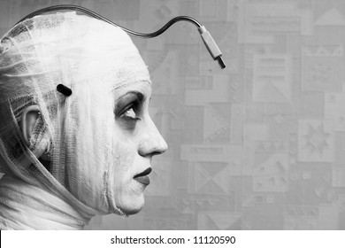 spooky female mime in heavy stage make-up