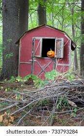 Spooky Halloween pumpkin in barn window