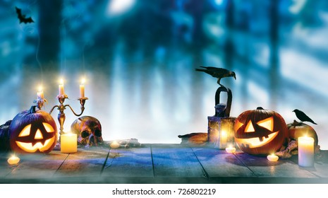 Spooky halloween pumpkins on wooden planks with dark horror background. Celebration theme, copyspace for text. Very high resolution image
