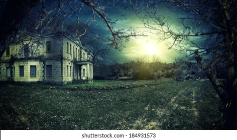 Spooky haunted house at dusk