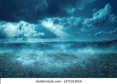 Spooky hills at night with moonlight and dark cloud background. Halloween background