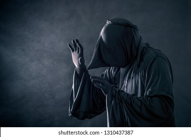 Spooky monster in hooded cloak