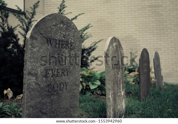 Spooky outdoor Halloween tombstone decorations