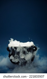 A spooky witch's cauldron with smoke coming out.
