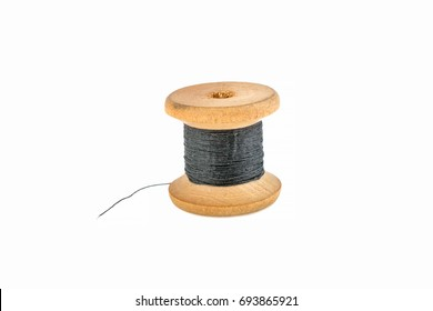 Spool with black thread on a white background
