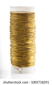 Spool with copper wire on a white background.
