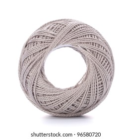 spool of grey thread isolated on white background