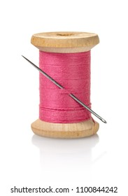 spool of pink threads on a white isolated background
