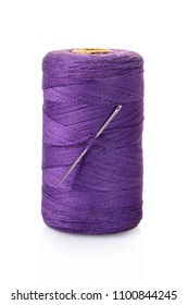 spool of purple threads on a white isolated background