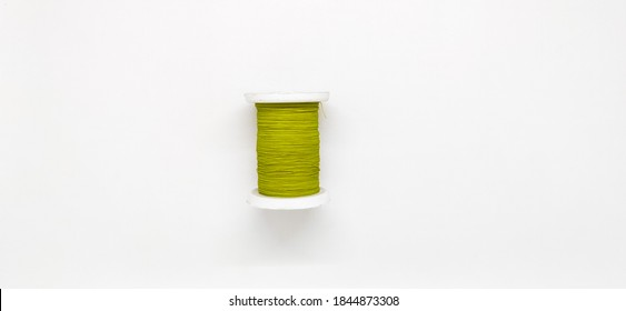 Spool of thread isolated on white background