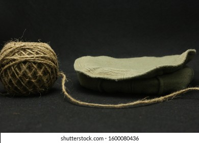Spool Thread And Warm Woven Hat Photography on Black Background