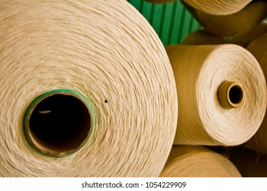Spools of Thread for Weaving Fabric in the Industrial Revolution