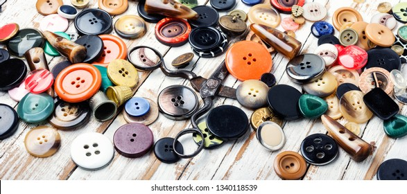 Spools of threads and buttons on wooden table.Needlework and tailoring concept