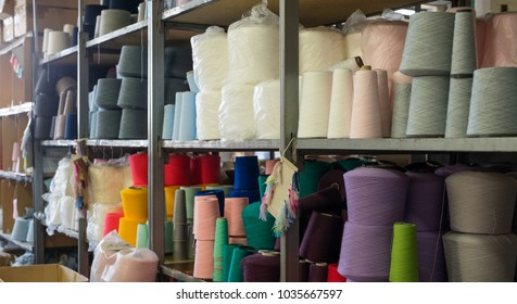 Spools with threads at knitting factory view