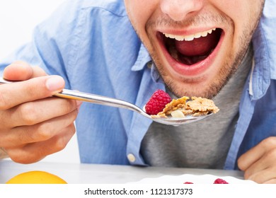 spoon with cereals and fruits, breakfast and healthy snack