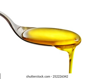 spoon of cooking oil isolated on a white background