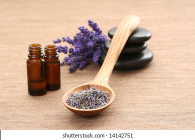 spoon of dry lavender and aromatic lavender oil