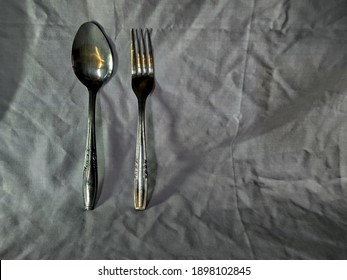 Spoon and fork with white background