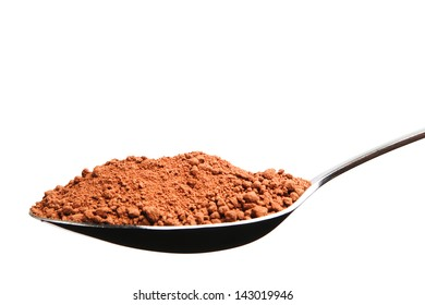 A spoon full of cocoa powder, isolated on pure white background.