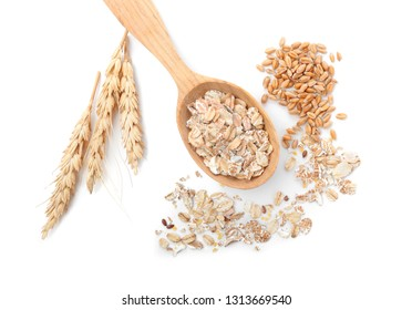 Spoon with oat flakes and wheat grains on white background