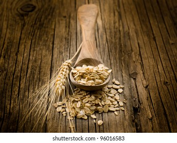 spoon with oat on wood background