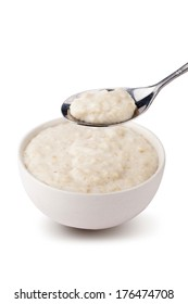 Spoon of  porridge over the bowl of  porridge. With Clipping pass